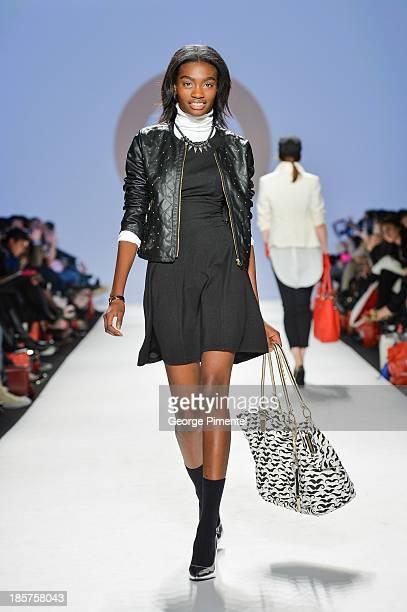 A model walks the runway wearing Target spring 2014 collection during World MasterCard Fashion Week Spring 2014 at David Pecaut Square on October 24...