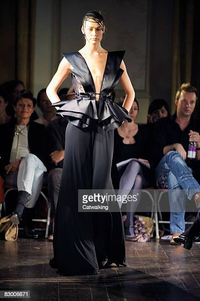 A model walks the runway wearing the Ana Sekularac Spring/Summer 2008/2009 collection during London Fashion Week on September 17 2008 in London...