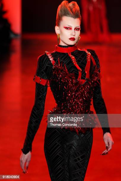 A model walks the runway wearing The Blonds Fall 2018 Collection with makeup by Kabuki Magic and the MAC Pro team hair by Kien Hoang and Oribe Hair...
