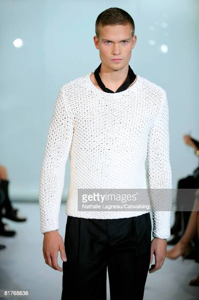A model walks the runway wearing the Cerruti Menswear Spring Summer 2009 collection during Paris Fashion Week on June 272008 in ParisFrance