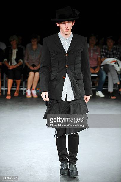 A model walks the runway wearing the Comme Des Garcon Homme Plus Menswear Spring Summer 2009 collection during Paris Fashion Week on June 272008 in...