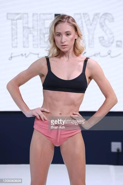 Model walks the runway wearing The Days Swimwear during NYFW Powered By hiTechMODA on February 08, 2020 in New York City.