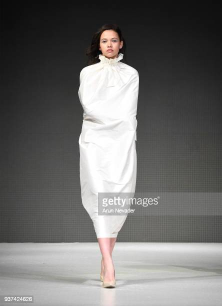 Model walks the runway wearing The House of Amz at 2018 Vancouver Fashion Week - Day 4 on March 22, 2018 in Vancouver, Canada.