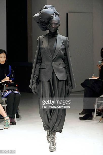 Model walks the runway wearing the Junya Watanabe Fall/Winter 2008/2009 collection during Paris Fashion Week on the 26th of February 2008 in...