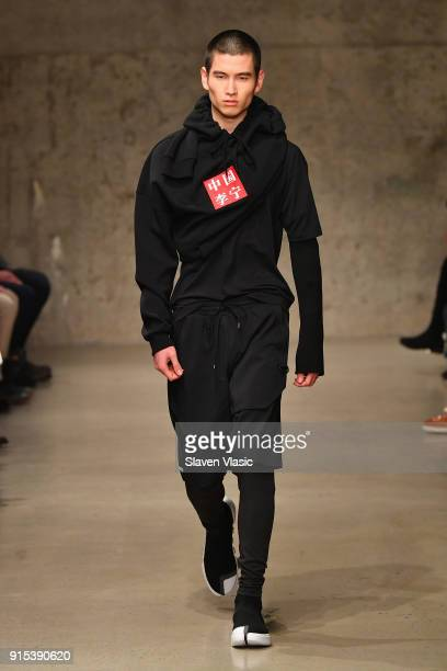 A model walks the runway wearing the LiNing Fall/Winter 2018 collection during 2018 New York Fashion Week at Skylight Modern on February 7 2018 in...