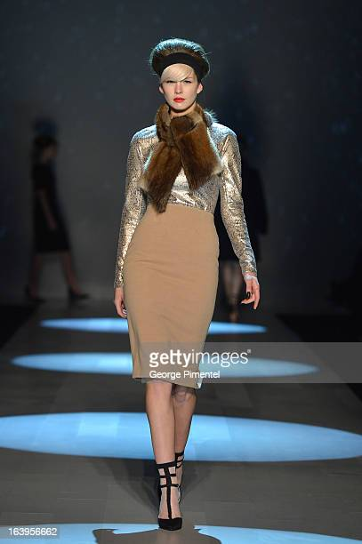 Model walks the runway wearing the Miz by Izzy Camilleri 2013 fall collection at David Pecaut Square on March 18, 2013 in Toronto, Canada.