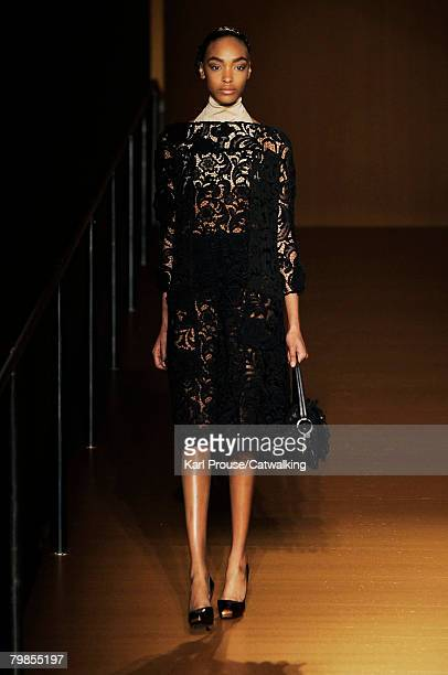 A model walks the runway wearing the Prada Fall/Winter 2008/2009 collection during Milan Fashion Week on the 19th of February 2008 in Milan Italy