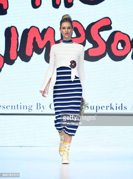 A model walks the runway wearing The Simpsons at 2018 Vancouver Fashion Week Day 6 on March 24 2018 in Vancouver Canada