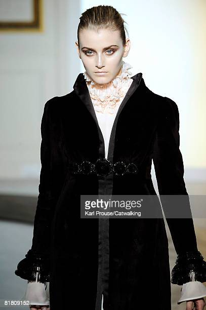 A model walks the runway wearing the Valentino Haute Couture Autumn Winter 2008 collection during the Haute Couture Paris Fashion Week on July 022008...