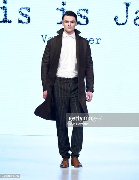A model walks the runway wearing This is James at 2018 Vancouver Fashion Week Day 7 on March 25 2018 in Vancouver Canada