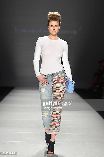 A model walks the runway wearing Triarchy 2016 collection during Toronto Fashion Week Fall 2016 at David Pecaut Square on March 17 2016 in Toronto...