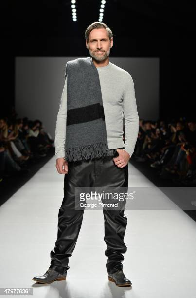 A model walks the runway wearing Triarchy fall 2014 collection during World MasterCard Fashion Week Fall 2014 at David Pecaut Square on March 20 2014...
