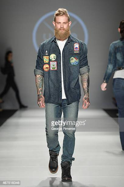A model walks the runway wearing Triarchy fall 2015 collection during World MasterCard Fashion Week Fall 2015 at David Pecaut Square on March 25 2015...