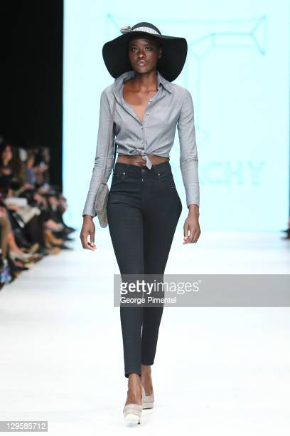 Model walks the runway wearing Triarchy spring 2012 collection during the Mercedes Benz Startup Event at David Pecaut Square on October 18, 2011 in...