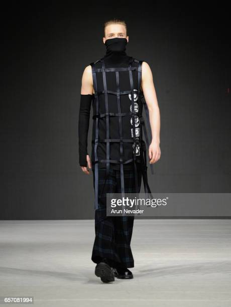 Model walks the runway wearing Tsung Yu Chan at Vancouver Fashion Week Fall/Winter 2017 at Chinese Cultural Centre of Greater Vancouver on March 23,...