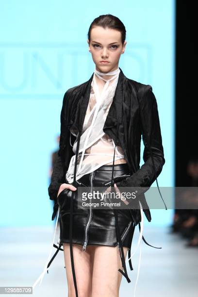 Model walks the runway wearing UNTTLD spring 2012 collection during the Mercedes Benz Startup Event at David Pecaut Square on October 18, 2011 in...