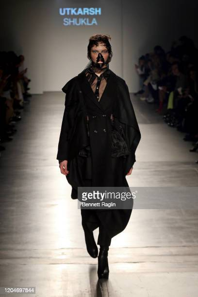 A model walks the runway wearing Utkarsh Shukla during the Fashion Institute Of Technology's Fine Art Of Fashion And Technology Show at Pier 59...