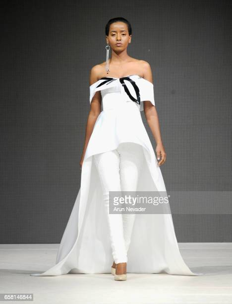 Model walks the runway wearing Viviane Valerlus at Vancouver Fashion Week Fall/Winter 2017 at Chinese Cultural Centre of Greater Vancouver on March...