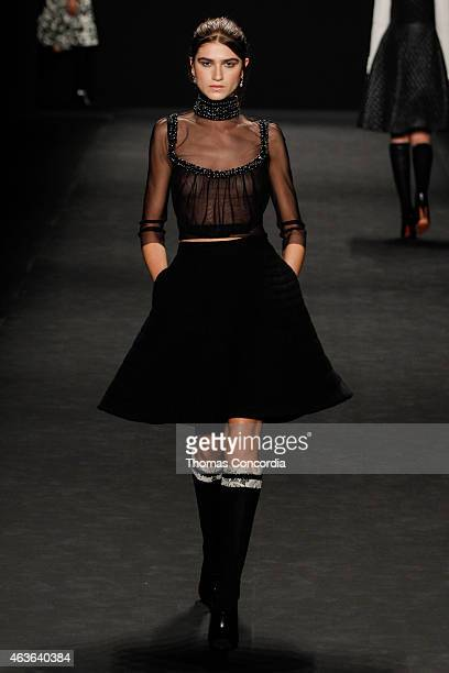 Model walks the runway wearing Vivienne Tam Fall 2015 during Mercedes-Benz Fashion Week at The Theatre at Lincoln Center on February 16, 2015 in New...