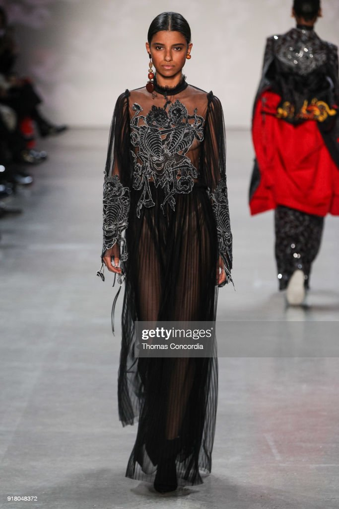 A model walks the runway wearing Vivienne Tam Fall 2018 with makeup by Fawn Monique and Hair by Moroccanoil at Gallery I at Spring Studios on February 13, 2018 in New York City.