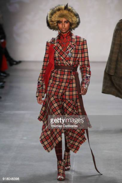 Model walks the runway wearing Vivienne Tam Fall 2018 with makeup by Fawn Monique and Hair by Moroccanoil at Gallery I at Spring Studios on February...