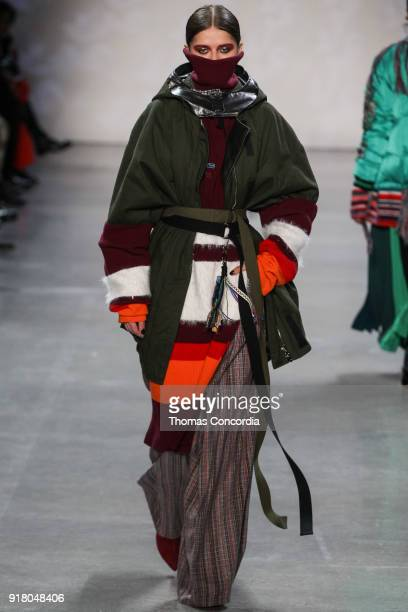 A model walks the runway wearing Vivienne Tam Fall 2018 with makeup by Fawn Monique and Hair by Moroccanoil at Gallery I at Spring Studios on...