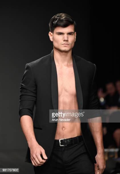A model walks the runway wearing Willfredo Gerardo at Los Angeles Fashion Week Powered by Art Hearts Fashion LAFW FW/18 10th Season Anniversary at...