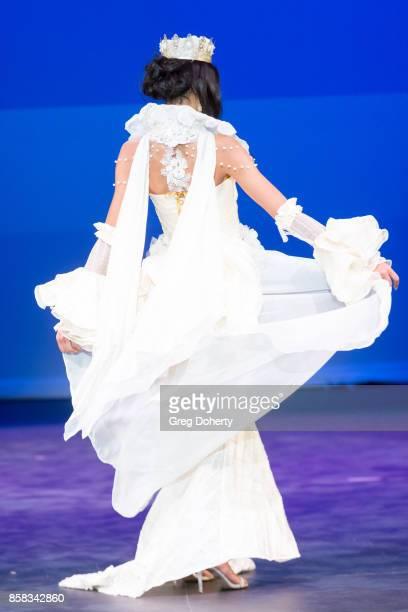 A model walks the runway wearing winning designs at the Metropolitan Fashion Week Closing Night Gala at Arcadia Performing Arts Center on October 5...
