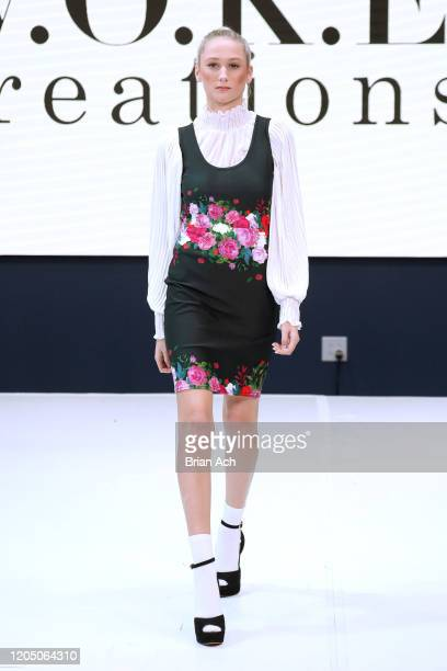 Model walks the runway wearing WOKE Creations during NYFW Powered By hiTechMODA on February 08, 2020 in New York City.
