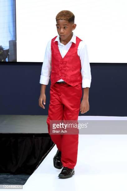 Model walks the runway wearing Wonderland Childrenswear during NYFW Powered By hiTechMODA on February 08, 2020 in New York City.
