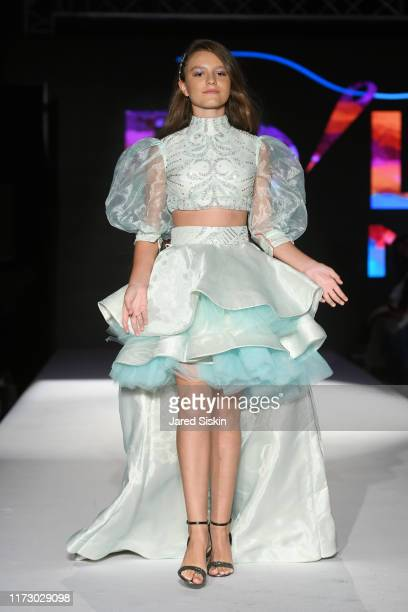 A model walks the runway wearing XXX during NYFW Powered by The Society at Broad Street Ballroom on September 07 2019 in New York City
