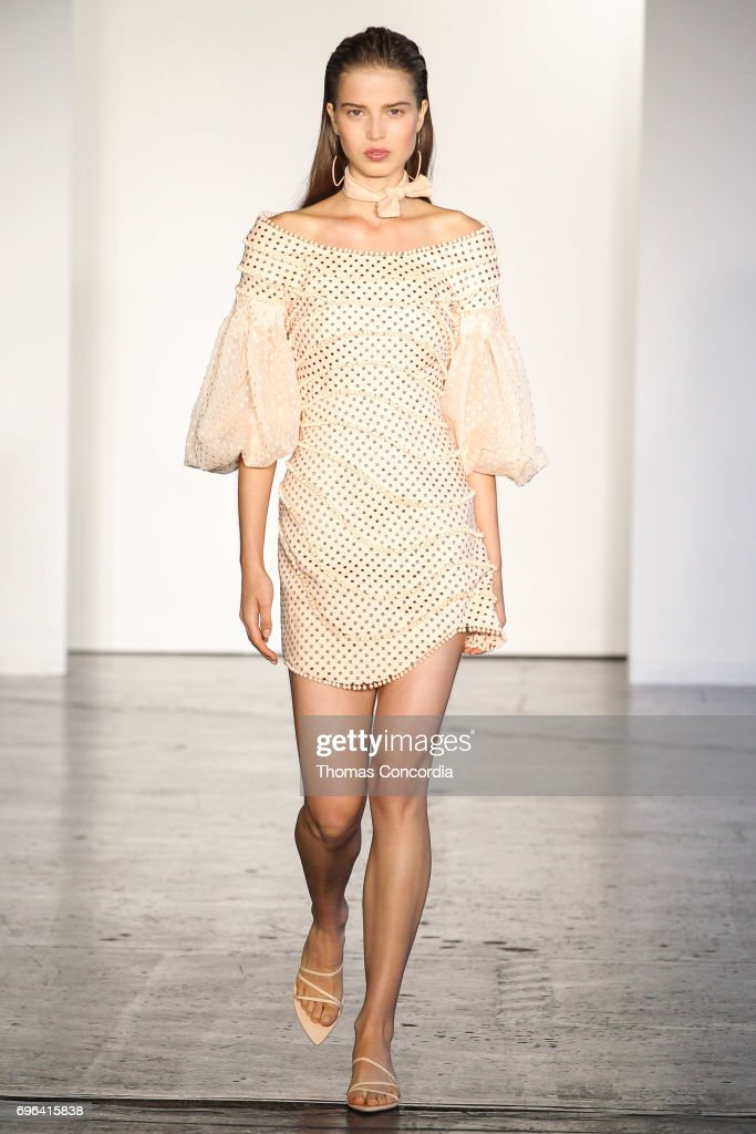 A model walks the runway wearing Zimmermann Resort 2018 at Industria Studios on June 15, 2017 in New York City.