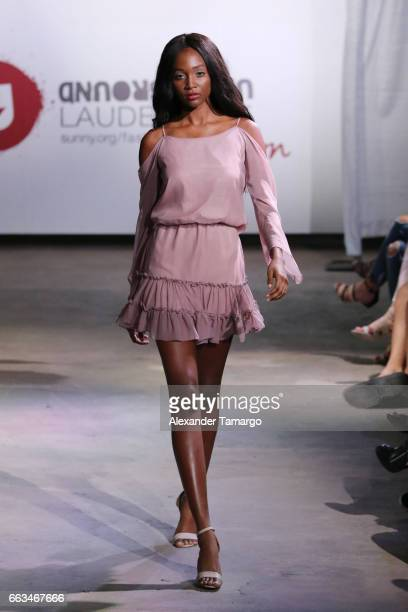 A model walks the runway wearing Zoey Reva at Underground Lauderdale Fashion Weekend Brought To You By The Greater Fort Lauderdale Conventions...