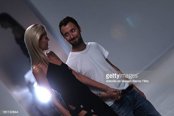 A model walks the runway with Anthony Vaccarello during his show as part of the Paris Fashion Week Womenswear Spring/Summer 2014 on September 24 2013...
