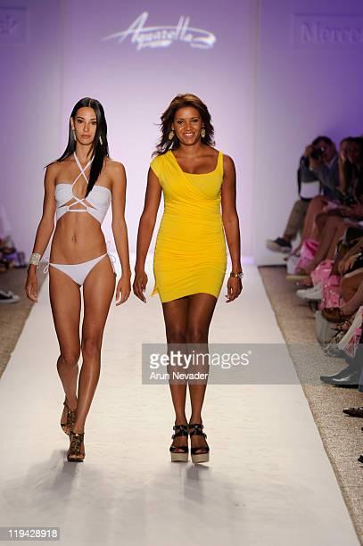 Model walks the runway with Designer Veronique de la Cruz for Aquarella Swimwear during MercedesBenz Fashion Week Swim at The Raleigh on July 18 2011...