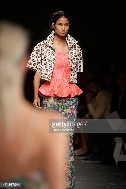 A model walks the runway with NYX Cosmetics at the Tracy Reese fashion show during MercedesBenz Fashion Week Spring 2015 at ArtBeam on September 7...