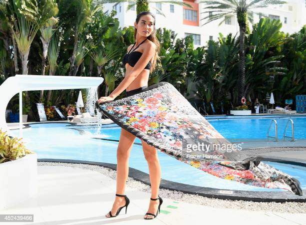 A model walks the runway with TRESemme at the Gottex presentation during MercedesBenz Fashion Week Swim 2015 at Raleigh Hotel on July 20 2014 in...