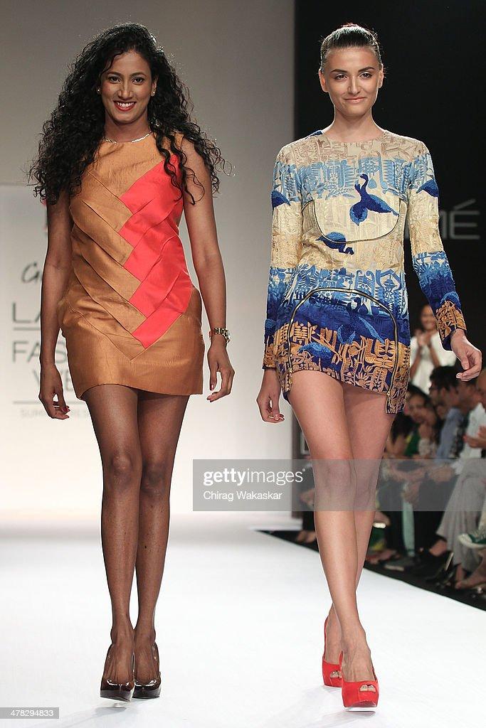 A model walks the runway with Vilvin Sabu (L) at day 2 of Lakme Fashion Week Summer/Resort 2014 at the Grand Hyatt on March 12, 2014 in Mumbai, India.