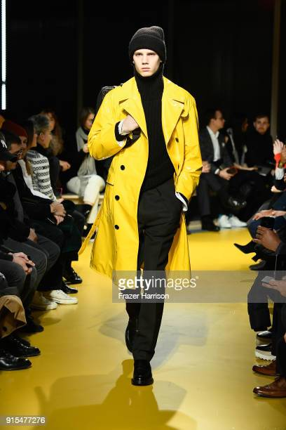 A model walks the runwayat BOSS Menswear February 2018 New York Fashion Week Mens' on February 7 2018 in New York City