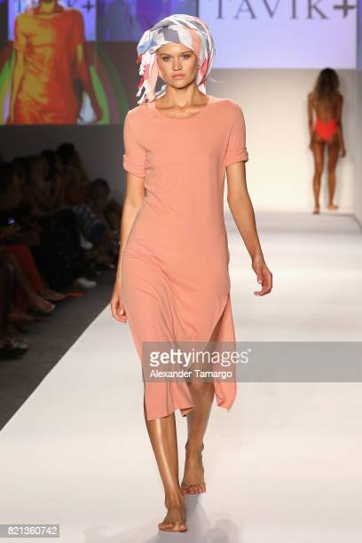 Model walks the ruwnay at SWIMMIAMI TAVIK 2018 Collection at SWIMMIAMI tent on July 23, 2017 in Miami Beach, Florida.