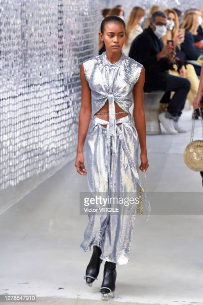 Model walks the sidewalk as runway during the Paco Rabanne Ready to Wear Spring/Summer 2021 fashion show as part of Paris Fashion Week on October 04,...