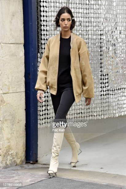 Model walks the sidewalk as runway from backstage to Stage during the Paco Rabanne Womenswear Spring/Summer 2021 show as part of Paris Fashion Week...