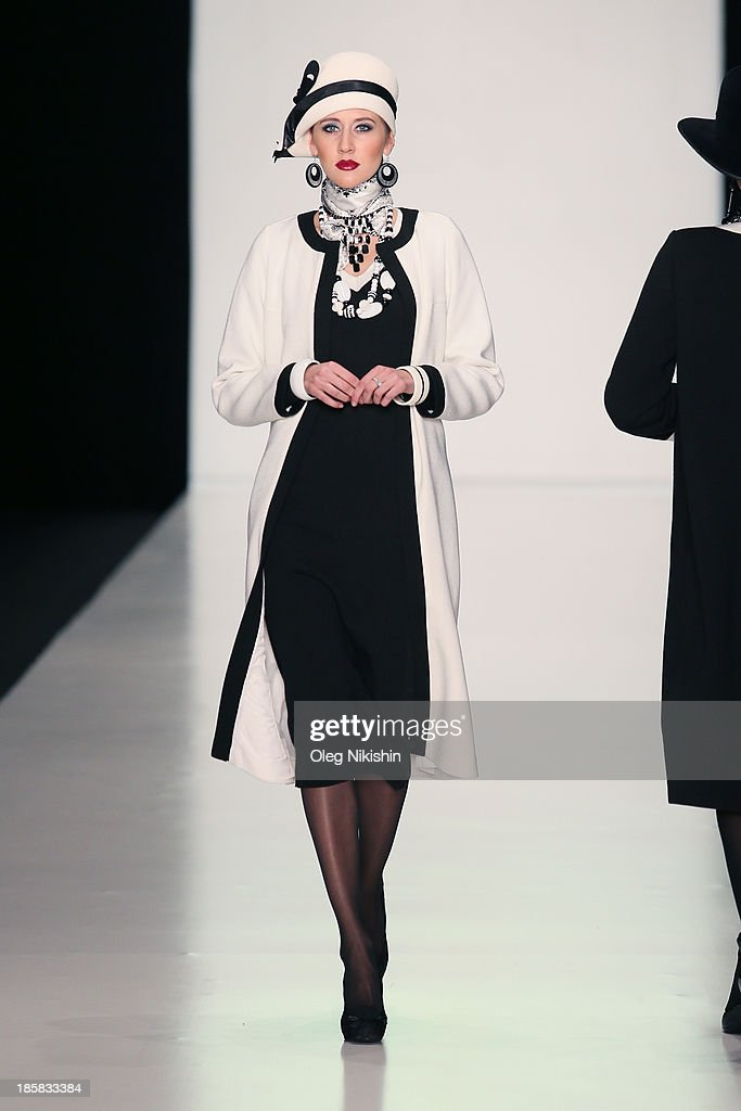 A model walks the SLAVA ZAITSEV For Ufa Knitwear LLC,TM 'TRICARDO' show during the Mercedes-Benz Fashion Week Russia S/S 2014 on October 25, 2013 in Moscow, Russia.