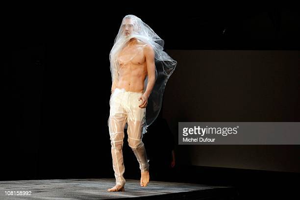 A model walks the Thierry Mugler Paris Fashion Week Menswear A/W 2011 show as part of Paris Menswear Fashion Week Fall/Winter 20112012 on January 19...