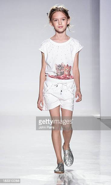 A model walks the TShirt TShops preview during the Swarovski at petiteParade NY Kids Fashion Week in Collaboration with VOGUEbambini on October 5...