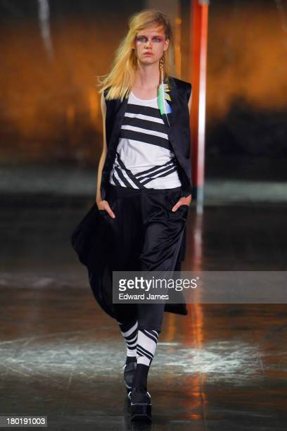 A model walks the Y3 runway during Spring 2014 MercedesBenz Fashion Week at Skylight at Moynihan Station on September 8 2013 in New York City