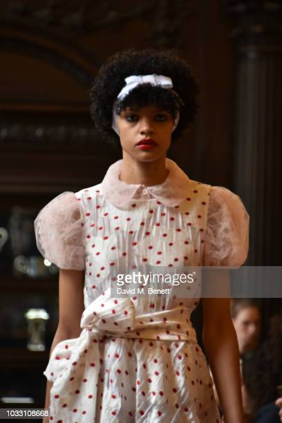 A model walks to runway at the Ryan LO show during London Fashion Week September 2018 at Stationers' Hall on September 14 2018 in London England
