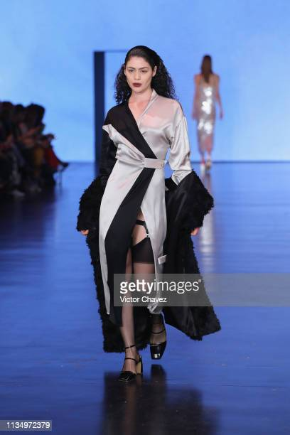 A model walks walks the runway during the Istituto Marangoni by Ssheena fashion show as part of the MercedesBenz Fashion Week Mexico Fall/Winter 2019...