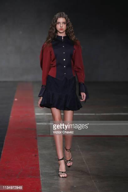 A model walks walks the runway during the Istituto Marangoni by Tiany Li fashion show as part of the MercedesBenz Fashion Week Mexico Fall/Winter...