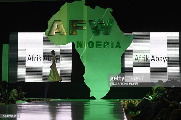 Model walks wearing Afrik Abaya designs during the African Fashion show in Lagos, on July 2, 2016. The Africa Fashion Week began at the weekend in...